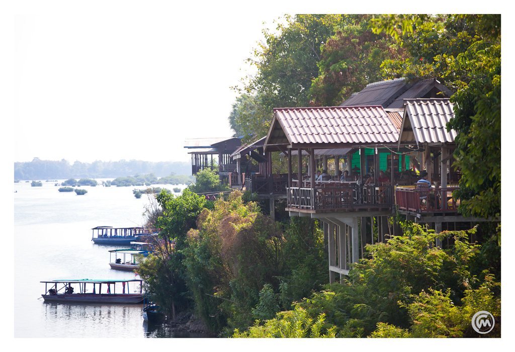 View of the guesthouses and decks overlooking the Mekong river on Don Khong island, Si Phan Don, Laos