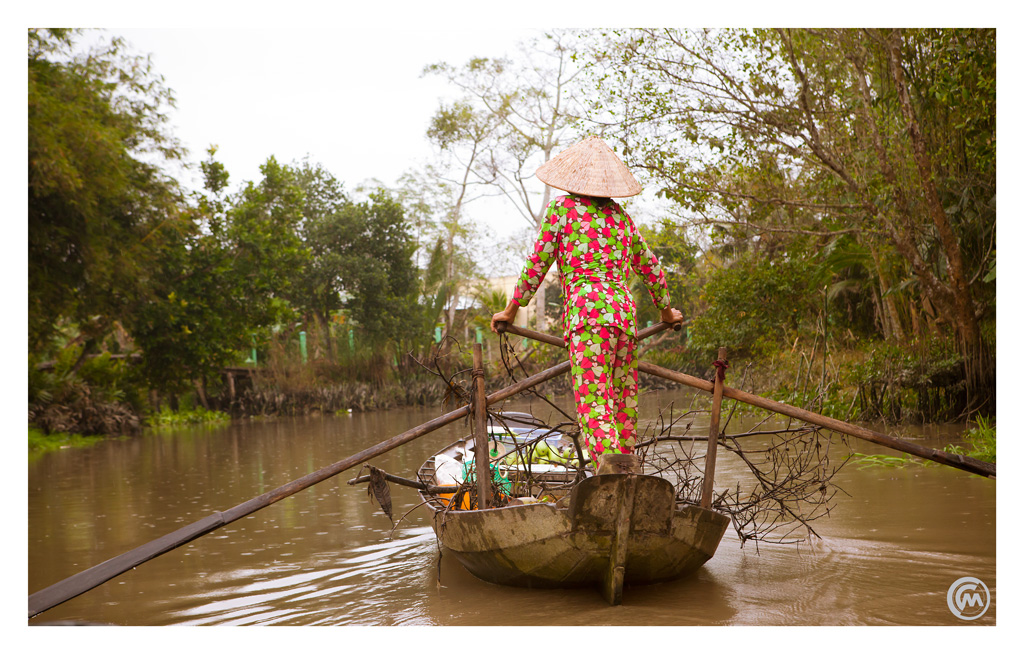 Woman on long tail boat, Mekong Delta, Vietnam