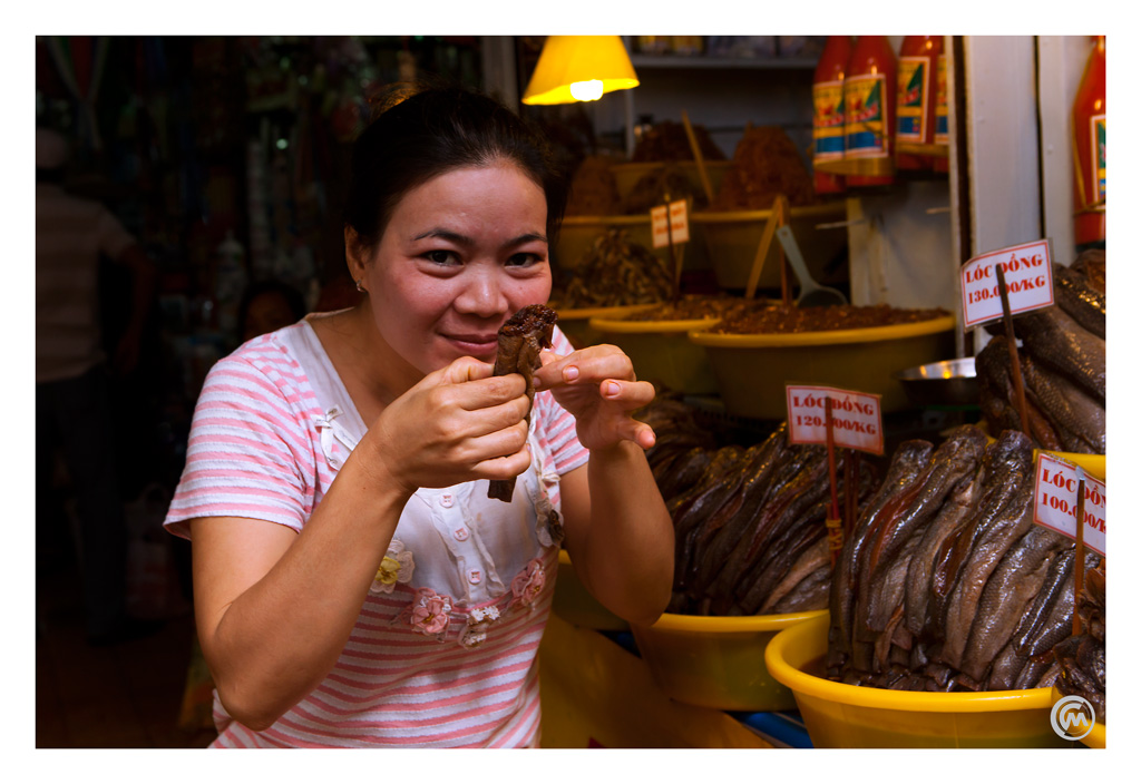 Lady selling fish at the Chau Doc market in Vietnam