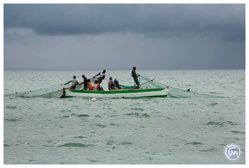 Men hauling in their nets